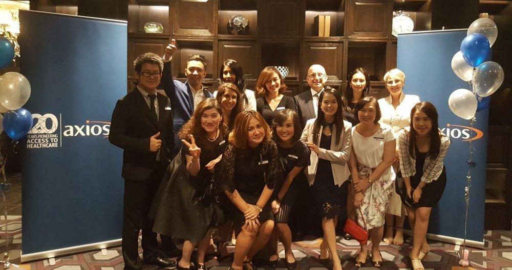 Our Bangkok team and members of Axios senior management celebrate. Pictured (left to right): Thitisate Thitirojanawat, Anuwat Chaipakdee, Roshel Jayasundera, U-marin Watcharinyanon, Joseph Saba, Atchariya Kunakornwong, Marie-Helene Besson, Sirikan Charradtrirutch, Plengpleawfah Itsariyawattananasak, Parnisara Boonpala, Thanika Chuakunta, Rungnapa Pantibun