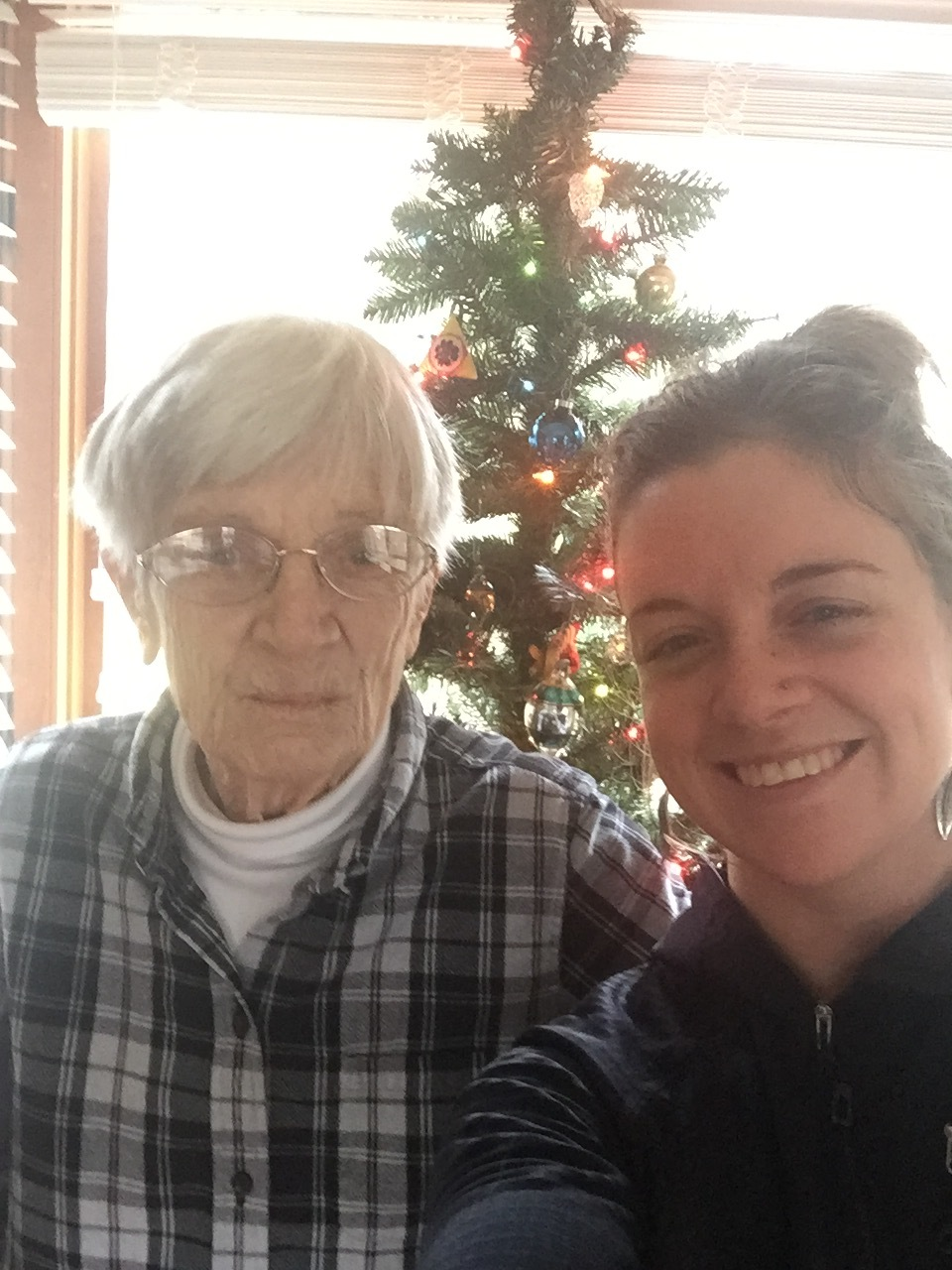 """""""Grandma, let's take a selfie with your Christmas tree!"""" (continuing traditions)"""