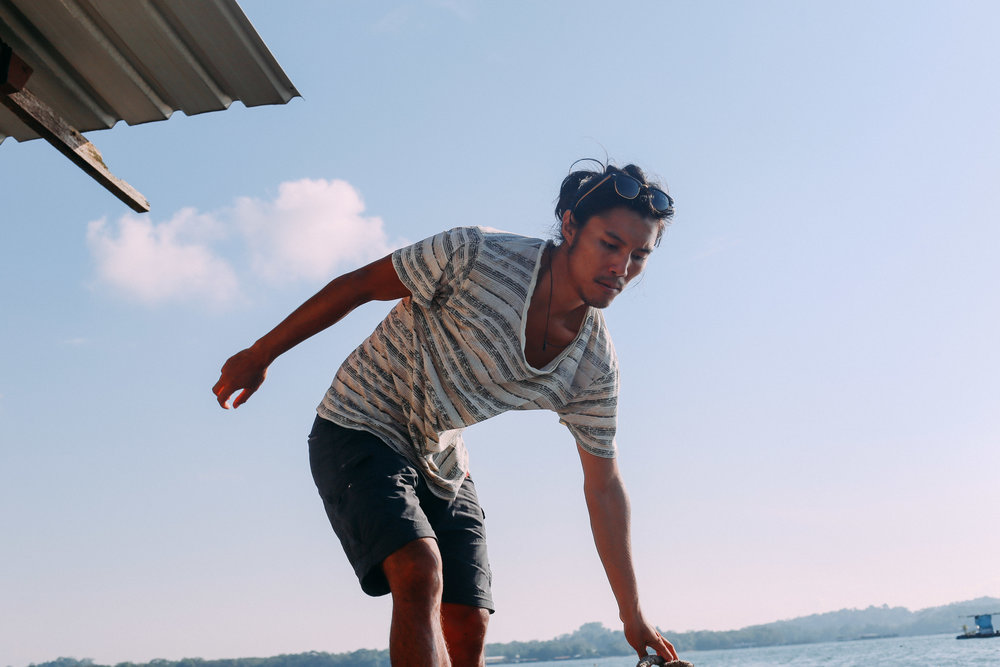 Marcus tries to find his balance as he steps off the kelong into the boat that is headed back to shore.