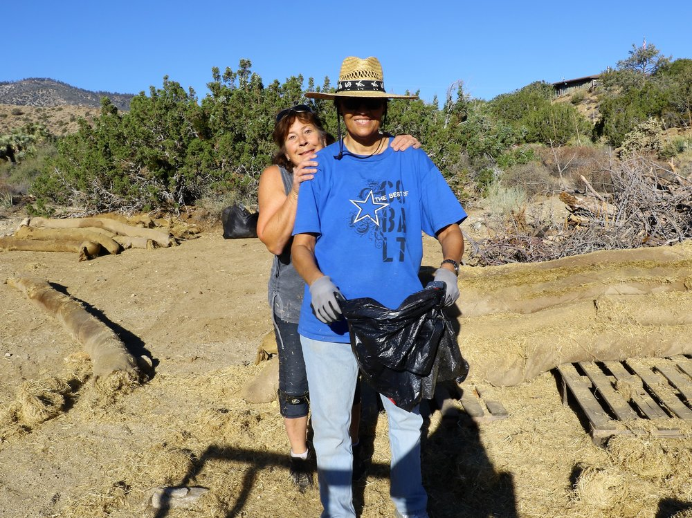 August 2018 Sue Harris and Angie Prudhomme work on salvaging used wattles that were donated to Transition Habitat from a Caltrans project. These wattles will be used for erosion control in various project areas.