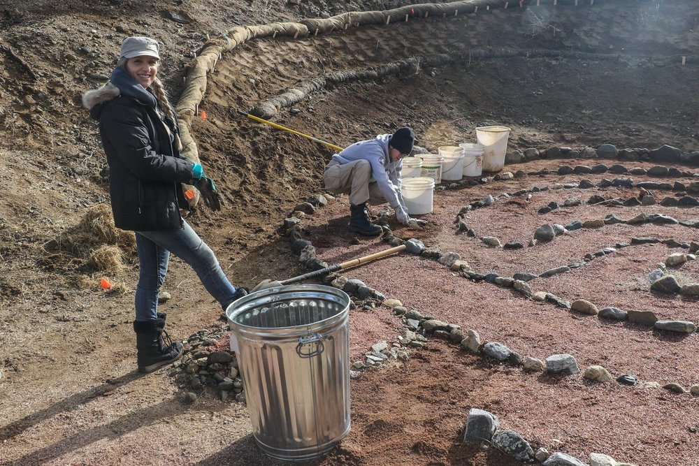 Gina Charpentier and AmeriCorps team member work on stabilizing the labyrinth and planting milkweed seeds in the Puma Canyon Ecological Reserve