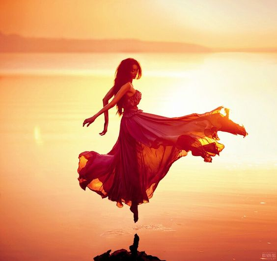 gown throw sunset pose.jpg