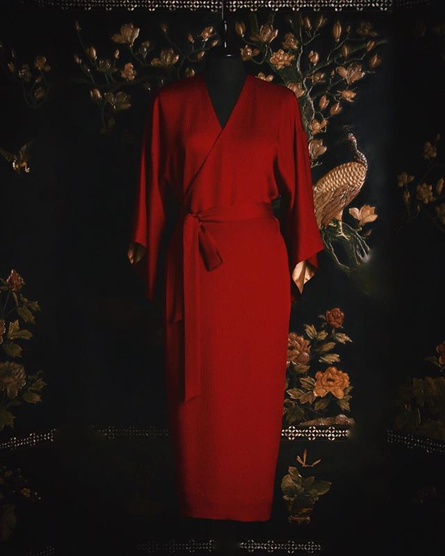 Kurenai | Wrap dress in deep red. In ancient Japan, red color was known to ward off evil spirits and protect you from negative energy.  紅色のラップドレス。日本では赤は古来から魔除けの力があると信じられている色。  #URAMUNÉ  #CollectionKinu  #TangoPeninsula  #silkcrepe  #Kyoto  #silk #Japanmade  #craftsmanship  #wrapdress  #日本の技  #伝統と革新  #紅