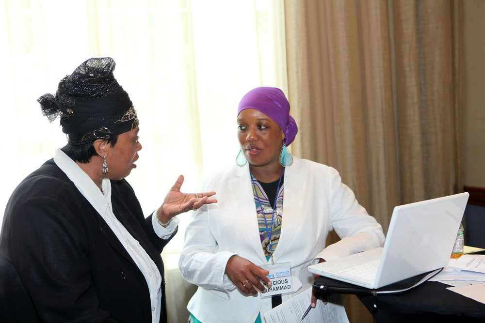 Precious discussing program plans with renowned singer Su'ad El-Amin, nationally known for her  message music . This photo was taken during the 2011 Community Life Forward conference, planned by a multi-generational, all volunteer team of African American Muslims from across the country.