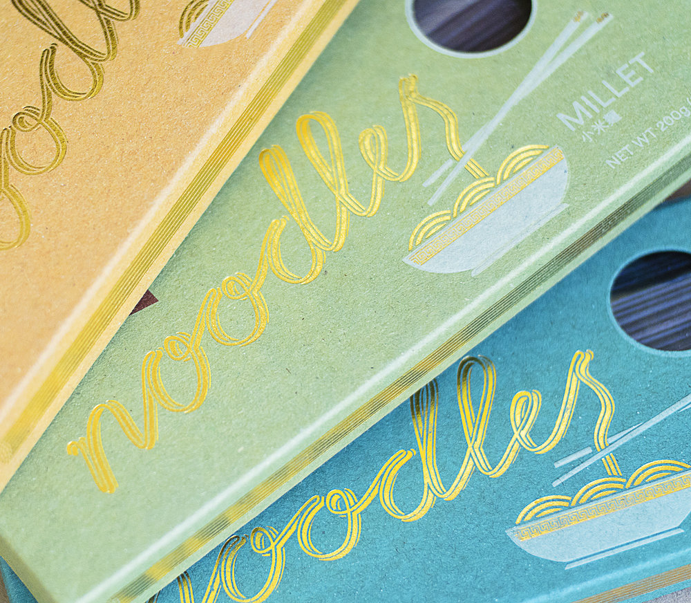Design of packaging for premium all organic, gluten-free noodles. The design is based on typography in the shape of noodles giving it a playful touch.