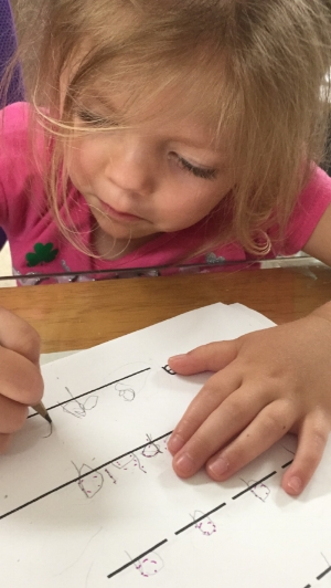 Her first attempt to write her whole name all by herself. Love the concentration!