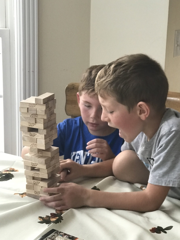 They played Jenga instead of getting their work done. This was the exact moment before they started arguing!