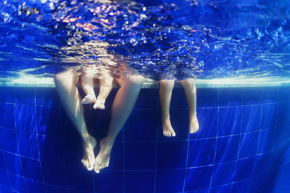 bigstock-Underwater-Photo-Of-Happy-Fami-94250930.jpg