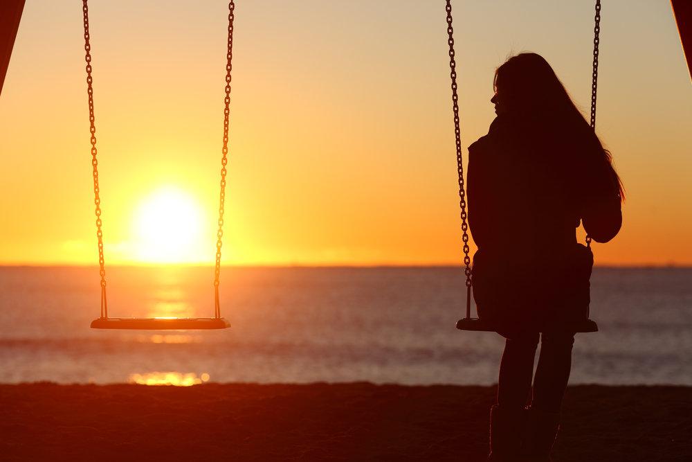 bigstock-Single-Woman-Alone-Swinging-On-84228041.jpg