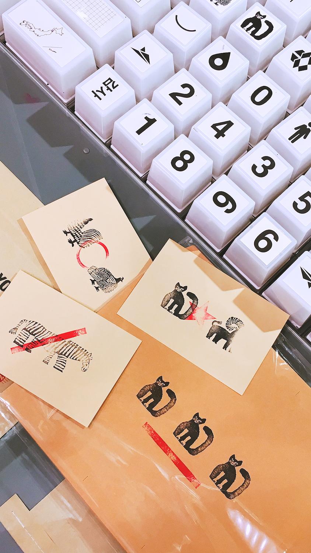 Stamping blank postcrads at Muji, Tokyo
