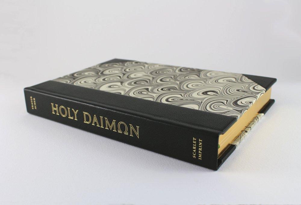 The fine edition, half bound in dark green goatskin with monochromatic marbled boards.