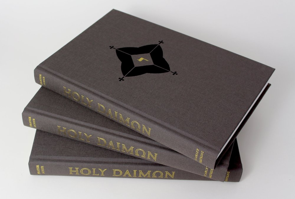 The standard hardback edition, bound in earthen grey cloth with gold and black design on front board.