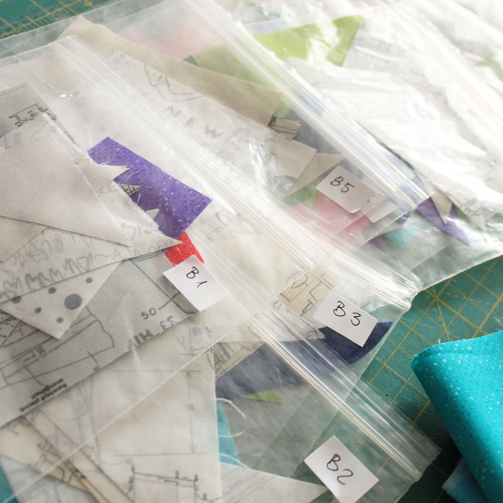 Organize your fabrics in clear bags. Use a bag of all needed pieces per block.