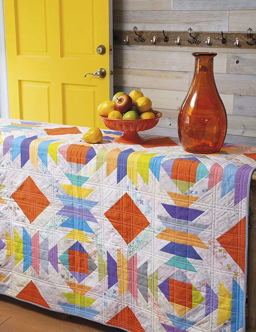 Pineapple Jelly Roll Quilt by Zen Chic, featured in the compilation book ON A ROLL by Martingale