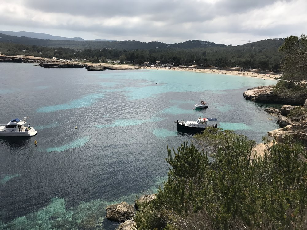 A view to Cala Bassa beach from the cliffs in April.