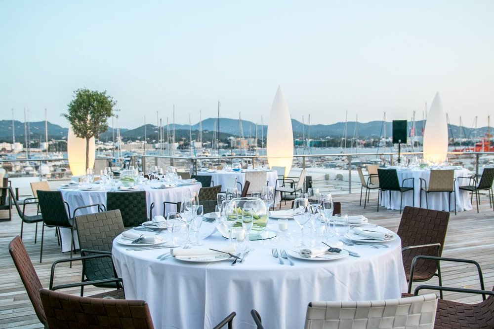 Wedding reception dinner at sunset, Es Nautic,San Antonio Ibiza. Photo by Dario Sanz.
