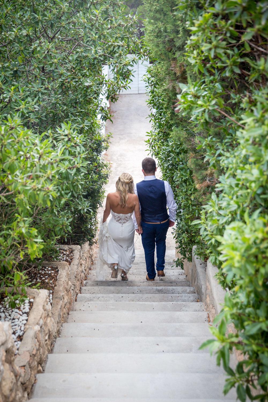Path to the beach. Wedding couple at Elixir Shore Club, Ibiza. Es Codolar. Photo by Matt Morgan.