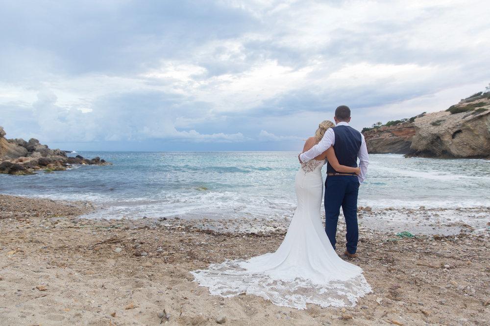 Wedding couple on the beach of Es Codolar, Elixir Shore Club, Ibiza. Photo by Matt Morgan.