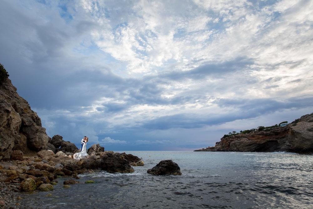 Bride and Groom kiss on the beach of Es Codolar, Ibiza. Photo by Matt Morgan.
