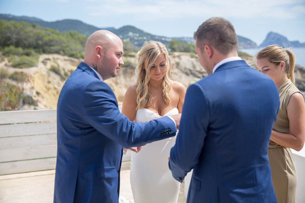 Exchanging rings in a wedding ceremony at Elixir, Ibiza. Photo by Matt Morgan.