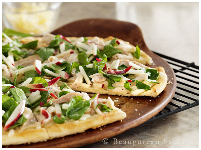 A unique White BBQ sauce accents this wonderful pizza.