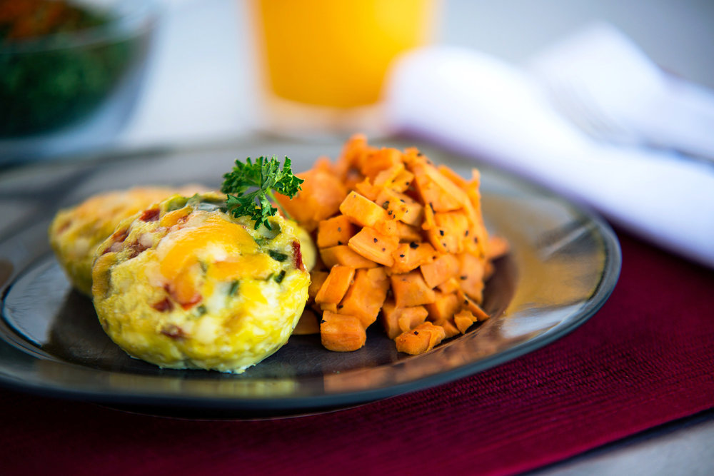 Egg Souffle w/ Sweet Potato Homefries   Calories: 291  Protein: 30g  Carbohydrates: 35g  Fat: 3g  Sugar: 1g  Gluten Free  Ingredients:Baked egg muffin tins with scrambled eggs mixed with egg whites. Mixed with sautéed peppers and turkey bacon. Served with diced sweet potatoes. There is no salt or seasonings added to this dish. The salt comes from the turkey bacon and cheese.