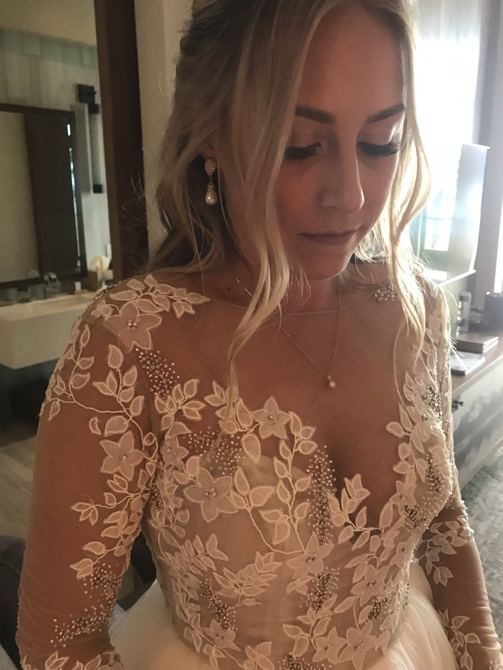All in the details with my Lorelei Gown by Hayley Paige. The earrings were my mom's on her wedding day and the diamond on my necklace was from my grandma's ring.