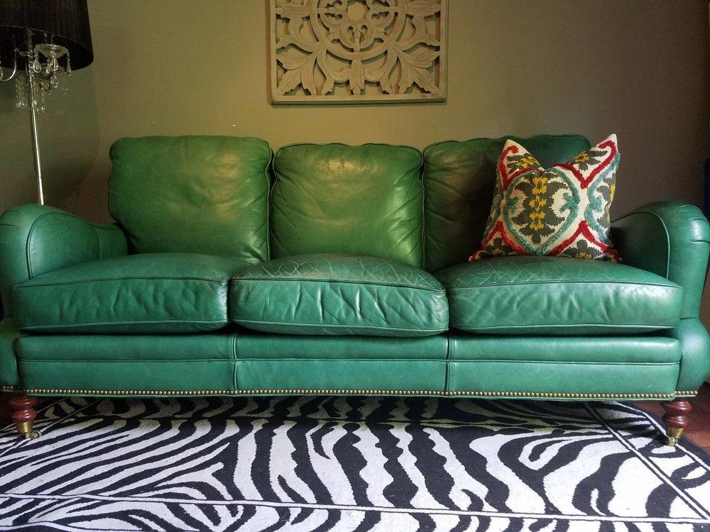 GREEN LEATHER SOFA - $345