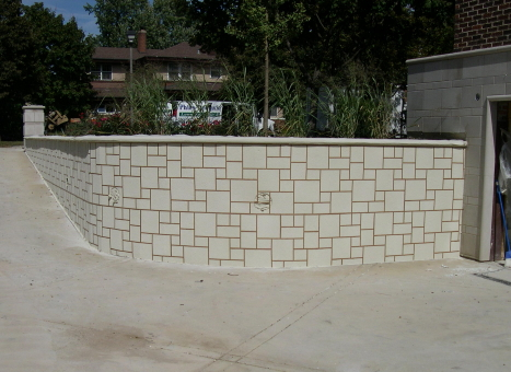 Cement Overlay Stencil Pattern Template Applied To Concrete Driveway Retaining Wall