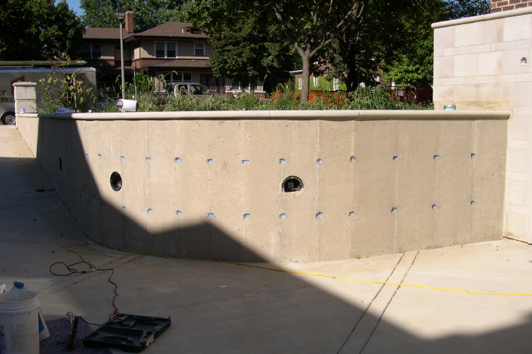 Surface Preparation And Repair Of Concrete Driveway Retaining Wall