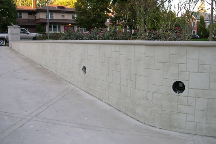 Long Driveway Concrete Retaining Wall With Patterned Cement Overlay