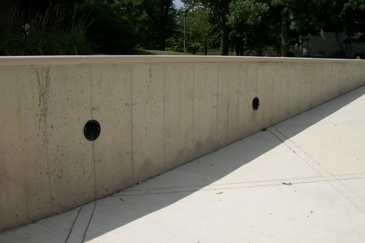 Newly Installed Concrete Driveway Retaining Wall Before Cement Overlay