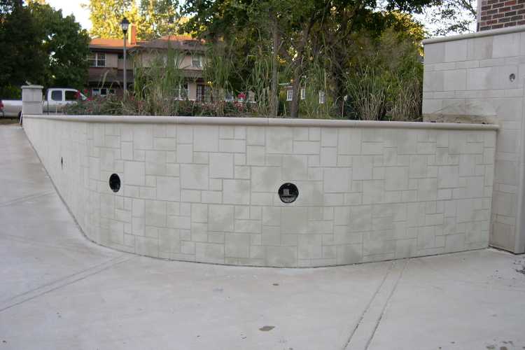 Limestone Block Pattern Cement Overlay of Driveway Concrete Retaining Wall With Invisible, Water- And Dirt-Repellent Sealer
