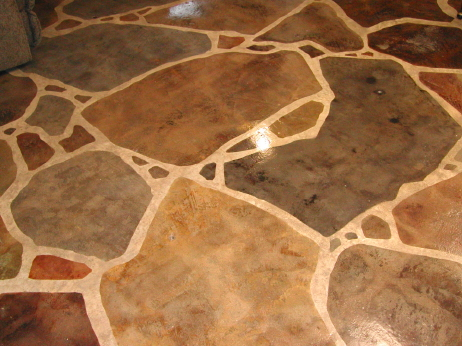 "This is a closeup of  a very realistic, faux-finish interior ""flagstone"" floor created by drawing a grout pattern on the concrete with soapstone and acid-staining the ""rocks"" one by one."