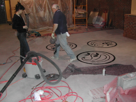 Concrete Stencil of Celtic Design Being Transferred To Irish Pub Restaurant Floor Prior To Engraving