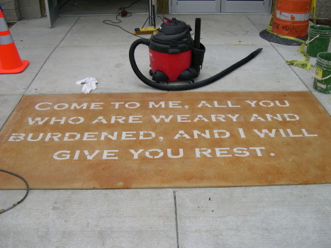 Acid-Stained Church Concrete Entryway With Engraving of Bible Verse
