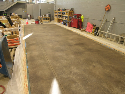 Warehouse Concrete Floor Acid-Stained Black Before Clear Sealing