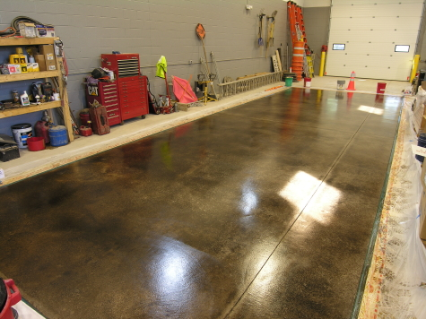 Warehouse Concrete Floor With Black Acid Stain and Clear Polyurea Sealer