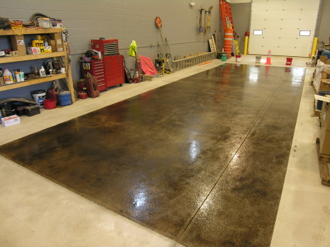 Warehouse Concrete Floor Acid-Stained Black With Clear Polyurea Sealer and Non-Slip Aggregate