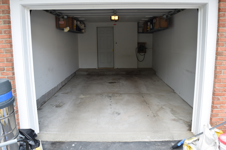 Dirty, Stained Existing Garage Concrete Floor Before Decorative Concrete Overlay