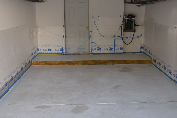 Acid-Staining Of White Cement Overlay Of Dirty Garage Concrete Floor