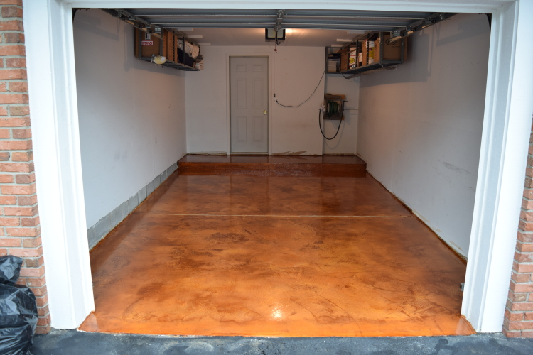 Terra Cotta Acid-Stained White Cement Overlay Of Garage Concrete Floor After Applying Clear Polyurea Sealer