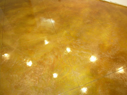 Closeup Of Bronze Acid-Stained Basement Concrete Floor With Saw-Cut Diagonal Tile Pattern