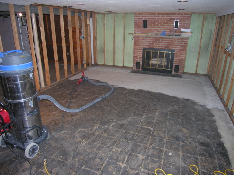 Black Cutback Tile Adhesive Being Diamond Ground Off Finished Basement Concrete Floor
