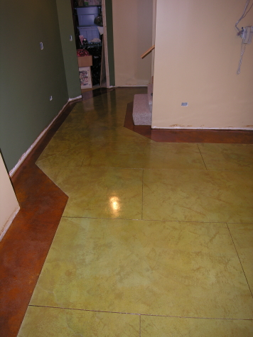 Acid-Stained Finished Basement Concrete Floor With Colored Border And Saw-Cut Design Pattern