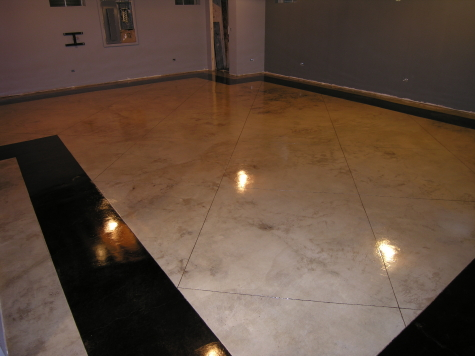 Finished Basement Acid-Stained Concrete Floor With Saw-Cut Tile Pattern And Black Border After Applying Clear Sealer And Floor Finish