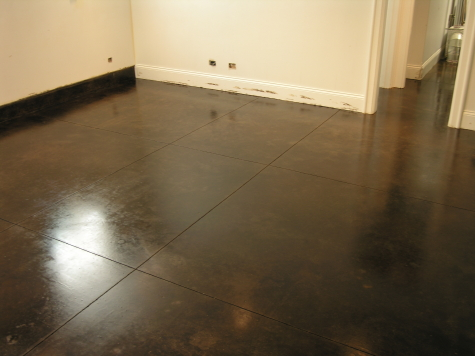 Dark Chestnut Brown Acid-Stained Basement Concrete Floor in Chicago With Clear Sealer
