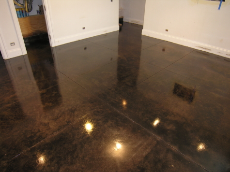 Dark Chestnut Brown Acid-Stained Basement Concrete Floor In Chicago With Clear Sealer And High Gloss Floor Finish