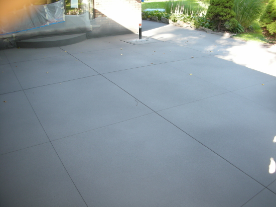 Decorative, Spray Texture Overlay Of Backyard Concrete Patio Before Clear Sealer