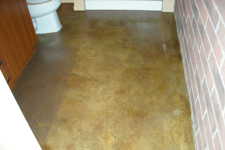 Loft Condominium Building Acid-Stained Concrete Bathroom Floor Damaged By Rubber Matting